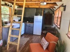 This is the Highland Home. It's a 10ft wide by 24ft long tiny home on wheels built by Incredible Tiny Homes out of Morristown, Tennessee featuring a thatched roof and window flower boxes. The…