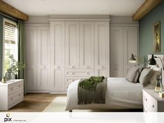 A heritage style bedroom with painted shaker fitted furniture. Heritage styling with classic sage greens and oil painting. Exposed beams an solid oak floor add real character. The bespoke fitted wardrobes idea hides clutter. Inspiration by http://www.setvisionspix.co.uk/