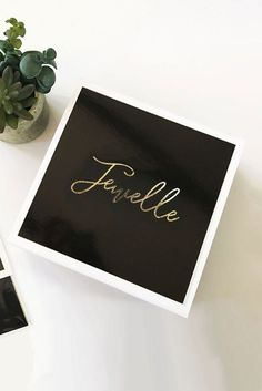 These personalized gift boxes are a classy way to package gifts for everyone in your bridal party! Each elegant box is personalized with a gold script name of your choice on top of th Bridesmaid Gifts Unique, Bridesmaid Ideas, Bridesmaids, Wedding Cards, Wedding Gifts, Wedding Planning Checklist, Reception Card, White Gift Boxes, Davids Bridal