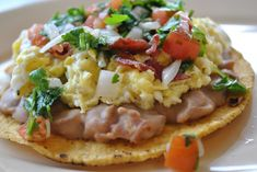 Breakfast Tostada-fat free refried beans (or just use black beans) and no meat