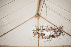 Blossom Hanging Arrangement   Absolute Canvas Marquee   The Garden Gate Flower Company   Amy Shore Photography   http://www.rockmywedding.co.uk/anna-tim/