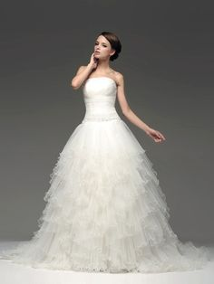 Latest Wedding Dresses from TopWedding. Strapless Ruched Ball Gown with Tiered Organza Skirt $238.99