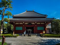 West/left of Sensoji, another Asakusa treasure: the Yogodo hall commemorating the 1200th birthday of famous Tendai Buddhism teacher Ennin/Jikaku Daishi (794-864) and housing the Yogoshu Buddhas-followers of Bodhisattva Kannon. Ennin helped Sensoji flourish after visiting in the 9th century and creating a duplicate of the original Kannon statue found by the Hinokuma brothers in the Sumida River. #Asakusa, #Sensoji, #Yokodo, #Ennin, #Jikaku 1/4 August 19, 2014 © Grigoris A. Miliaresis