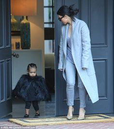 Patience is a virtue: Kim urged North along as they emerged from a building