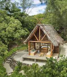 "Constance Tsarabanjina Resort: Swank, private little huts on the beach, just steps away from the beautiful blue tropical ocean surrounding the Madagascar islands. discover ""glamorous camping"" resorts and destinations worldwide Bamboo House, Tiki Hut, Beach Bungalows, Beach Shack, Beach Huts, Tropical Houses, Tropical Plants, Africa Travel, Beach Cottages"