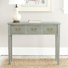 @Overstock - Perfect for adding a welcoming touch to an entryway or a hallway, this Sete 3-drawer console table in antiqued grey also looks fantastic in a living room, dining room, or bedroom. Built from solid elm wood, it offers lasting appeal.  http://www.overstock.com/Home-Garden/Sete-3-drawer-Antiqued-Grey-Console-Table/6605268/product.html?CID=214117 $166.49