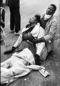 Amelia Boynton Robinson lays beaten and tear gassed on the Edmund Pettus Bridge in Selma, Alabama. She was attempting, along with up to 600 other marchers, to cross the bridge from Selma to Montgomery, but the marchers were stopped and beaten by police, March 7, 1965  Photo credit: Bettmann / Corbis — in Selma, Alabama.