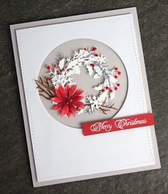 This beautiful white and silver Christmas wreath is made using Penny Black and Impression Obsession dies and a few Copic markers.