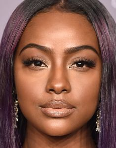 Celebrities and supermodels gathered at the amfAR Gala in droves in some of the best hair and makeup we've seen so far in 2018. Justine Skye's flawlessly trimmed arches made us drool. Her purple highlights perfectly balance her bronze eye shadow.
