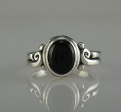 Sterling Silver Ring with a 9 x 7 mm Black Onyx Cabochon, Size 8 I can size it to fit, just contact me. No charge to size down, and no charge for one size up. The top of the ring measures