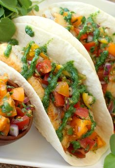 These Fish Tacos with Tomato Salsa and Fresh Watercress Sauce are loaded with flavor and healthy ingredients!