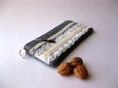 Zippered pouch with lace.
