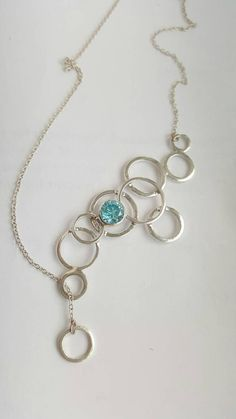 Beautiful unique silver circles pendant with blue by AnJaJewellery