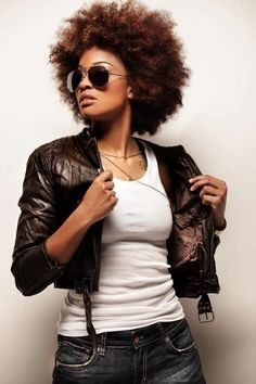 OMG! Has to be one of my favorite pics ever. She rocks! (natural hair, big afro)