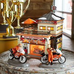 Department 56 Original Snow Village Harley Davidson Collection. For more info visit http://www.department56.com Shop 24/7 http://shop.department56.com HARLEY, HARLEY-DAVIDSON and the Bar & Shield Design are among the trademarks of H-D U.S.A., LLC ©2014 H-D and its Affiliates. All Rights Reserved. Department 56 is a licensee of Harley-Davidson Motor Company.