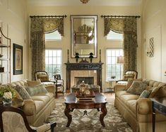 Draperies & Window Treatment Design. Asymetrical valances and floor to ceiling drapery panels dress these windows beautifully..