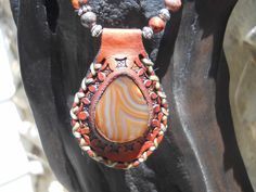 Leather pendant set with red agate. Strung with red chrysocolla, ocean jasper, African turquoise, coral, carnelian, howlite and silver-plated brass beads. Silver-plated brass fob clasp. $80. BP5. http://www.feeko.co.za