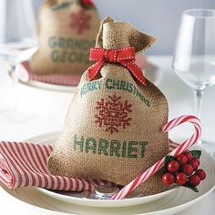 Personalised Mini Christmas Sack £8 These are cute, but pricey for nowt in them. Must be a way to cheat these!