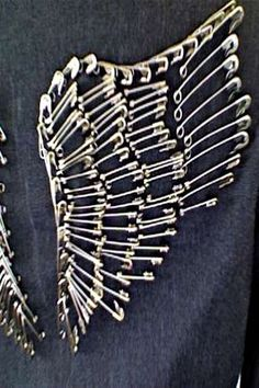 Safety Pin Wings - tutorial on arranging safety pins on fabric. How cool to decorate the back of a denim jacket or tote bag!
