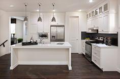 Light, white kitchen, dark wood floor