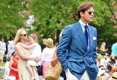 Tommy Ton at the Veuve Clicquot Polo Classic- He is wearing a stunning suit and has amazing hair. #mens fashion #clothing #outerwear