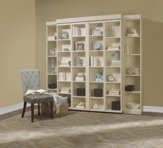 Madison Bifold Bookcase Bed 2   Murphy bed that looks like a bookcase: You slide out the middle shelves to reveal a full bed. from Houzz     Thank you for reporting this. Undo   Daphne Berg