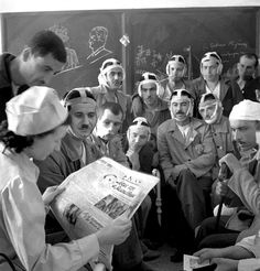 Greek Army soldiers, wounded during battle with Axis Italian troops in Italian-occupied Albania, listen intently to a Greek nurse as she reads the weekly Nike newspaper about the ongoing Greco-Italian War as they recover in an Athens hospital. Division, Greek Warrior, Greek History, Army Soldier, German Language, In Ancient Times, Panzer, New Media, World War Ii