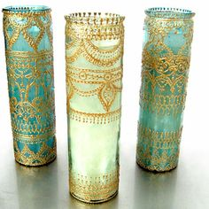 Mehndi decor - LOVE this! Colored vigil candles decorated with puff paint! @ Wedding Day Pins : You're #1 Source for Wedding Pins!Wedding Day Pins : You're #1 Source for Wedding Pins!