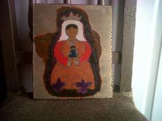 virgen Coromoto repujada en lame y fomy y montada sobre madera.