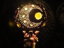 """The JI4003  hanging lamp is made from the Mexican Jicara fruit which is native to only South America and Mexico. The lamp features one of the Jellyfish moon designs. The lamp is made from all natural materials and has intricate hand carved designs and multiple incrustations of colored marbles and glass. The lamp is approximately 5.7"""" diameter and comes complete with a 6' UL approved cord with on/off switch and a 15 watt bulb. Light up the night!"""