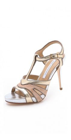 DIANE VON FURSTENBERG  JULIP SANDALS $160.12 Contrast piping highlights the soft suede and metallic leather panels on these glam DVF sandals. Buckled ankle strap. Covered heel and leather sole.