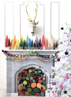 Multicoloured Christmas decorations including bottle brush trees, white Christmas tree with colourful baubles and coloured logs in fireplace Bohemian Christmas, Christmas Love, Merry Little Christmas, Winter Christmas, Vintage Christmas, Whimsical Christmas, Father Christmas, Christmas Trees, Retro Christmas Decorations