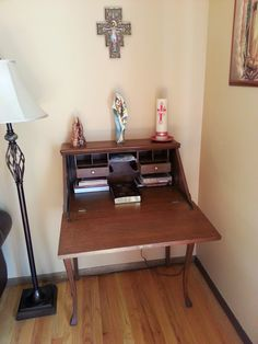 I love this idea, you can use the desk alter as a place to rest your hands and keep a kneeler under the alter.  It also keep visitors and children from messing with pieces you may not want them to.
