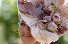 Royal Ascot hat.  A little busy for my taste, but beautiful colors and it suits her well.