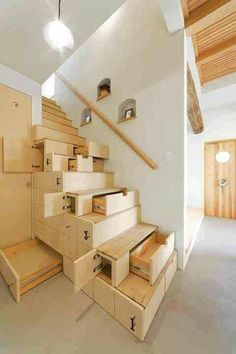 Usually stairs are a waste of space;  this one is a treasure of storage.