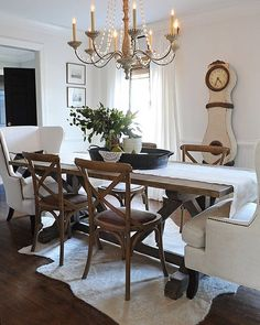 """""""Swapping out table linens is an easy and inexpensive way to add a spring touch to your home. We replaced our darker burlap runner for a lighter white one, which immediately brightened the room. We also added these white chairs from Birch Lane (my absolute favorite addition!) which I love for their comfort and style."""" - @dearlillie #blspringrefresh #birchlane #spring #refresh #diningroom #linens"""