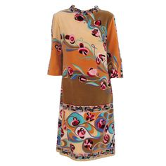 View this item and discover similar for sale at - Early Pucci velvet mini dress in soft apricots, peach & muted gold/fawn with Pucci's vibrant colourfully patterned banded swirls.A line dress has 1960s Fashion, Timeless Fashion, Love Fashion, Vintage Fashion, Fashion Outfits, Tribal Fashion, Vintage Dresses, Vintage Outfits, Unique Outfits