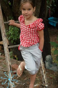 Little girl clothes that are classic.  Ruffles on the pockets