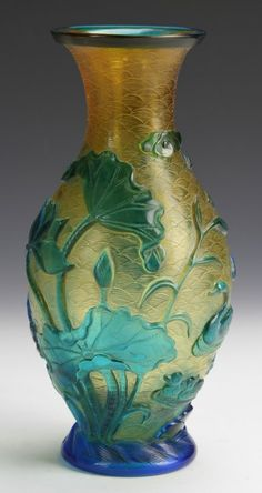 Chinese Peking Glass Vase China, 19th C., yellow Peking glass vase with overlay carvings of green flowers and swimming ducks, mark on base. Height 9 1/2 in.
