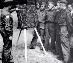 British soldiers being trained in German phrases for POW control. According to the board: Hands up! Put that revolver down! Turn around and keep walking! British Soldier, British Army, Revolver, Operation Sea Lion, Home Guard, Ww2 Photos, Walking, Bad Picture, Learn German