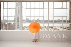 Planned, Designed & Produced by www.swankproductions.com Clean Modern Rooftop Wedding at studio 450. Umbrella party favors #favors #modern #wedding #rooftop #reception #decor #inspiration #ideas #creative #beautiful clean #white #orange #yellow #studio #450