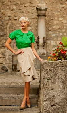 *Tweed pencil skirt in camel or dark grey with cascading ruffle detail * Camel: Wool and Polyester blend. Acetate liner. *