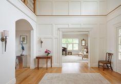 crisp white molding, architectural details, and hardwood floors