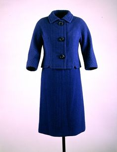 Blue checked wool tweed suit, by Chez Ninon, American, ca. 1960. Worn by Jacqueline  Kennedy during a tour of the Vienna porcelain factory, Vienna, Austria, June 3, 1961.