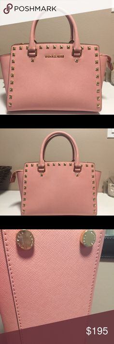 Authentic gently used Michael Kors purse Gently used, Michael Kors pale pink, medium Selma studded purse.  Saffiano leather. Only used a handful of times. In great condition. Michael Kors Bags Satchels