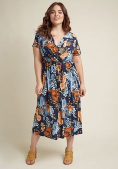 <p>Start your weekend off with a morning stroll wherein the sun shines down on this navy blue frock's cap sleeves and surplice neckline. The vent gracing its hem's left side is a chic touch that'll style your afternoon's museum visit to a T! And, when you adjust into margarita mode, the sky, peach, and rust floral pattern of this midi is ready to rise to the occasion of looking fabulous al fresco.</p>