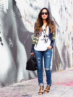 Aimee Song of Song of Style dresses up a graphic tee + jeans with a colorful jacket and strappy heels