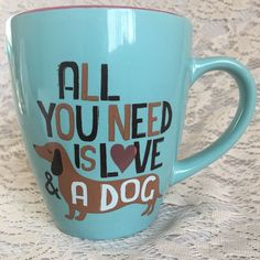 """Super cute image of a Daschund dog / """"Wiener dog"""" on front & back. All You Need is Love & a Dog (Daschund) - Coffee Cup Mug. Gorgeous mint-colored on outside and dark pink on inside of mug. Has the word Love with a heart inside the mug. 