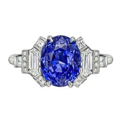 Raymond C. Yard 4.20 Carat Sapphire & Diamond Ring. Sapphire ring in a fancy platinum setting with diamond shoulders. Oval-shaped sapphire weighing 4.20 carats (certified: natural, no indications of heat treatment) flanked by trapeze-cut, baguette-cut and round-cut diamond accents, the diamonds altogether weighing 0.97 total carats. Designed by Raymond C. Yard.  C 2014