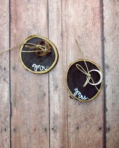 Perfectly pocket-sized for your wedding ceremony! Mr. and Mrs. hand-painted ring holders made from wood slices and twine | By Ashley Pahl
